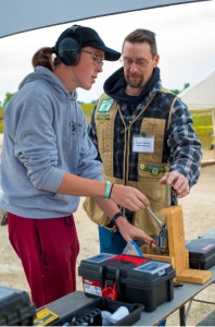 4-H volunteer working with youth