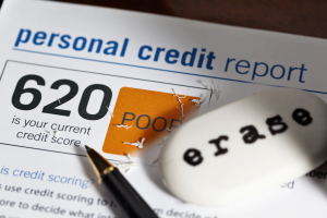 picture of a credit report and an eraser